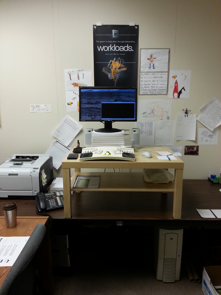 A photo of my office after setting up my standing desk.